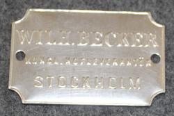 Wilh Becker, Kongl Hofleverantör, Stockholm, nikkeli