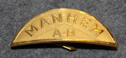 Byggnads AB Manhem, Construction company helmet badge.