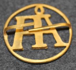 Åhlen & Holm, department stores. 27mm badge.