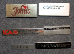 Lantmännens maskin, Elev, Weist, Johns. Corporate name tags.