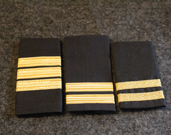 Navy shoulder rank loops.