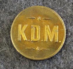K.D.M.