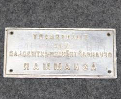 Ofvansjö Trävaru-Aktiebolag, Åshammar, puutavarayhtiön kilpi.