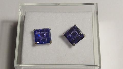 Hopeakorvakorut, iso violetti neliö kivi
